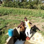 The Water Project: Timbito Community, Wakamu Spring -  Jentrine Nanzala With Field Officer Jemmimah Khasoha