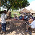 The Water Project: Alimugonza Community -  Simon Conducting Training