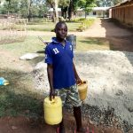 The Water Project: Lusiola Primary School -  Bringing Water To Mix Cement