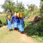 The Water Project: Shivanga Primary School -  Carrying Water To School