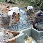 The Water Project: Ewamakhumbi Community, Yanga Spring -  Backfilling