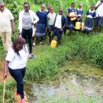 The Water Project: Shikusa Primary School -  Organization Staff Inspecting The Source
