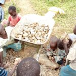 The Water Project: Mungaha B Community, Maria Spring -  Children Sorting Through Stones