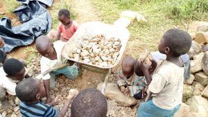 The Water Project:  Children Sorting Through Stones