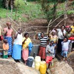 The Water Project: Isembe Community, Amwayi Spring -  Flowing Water
