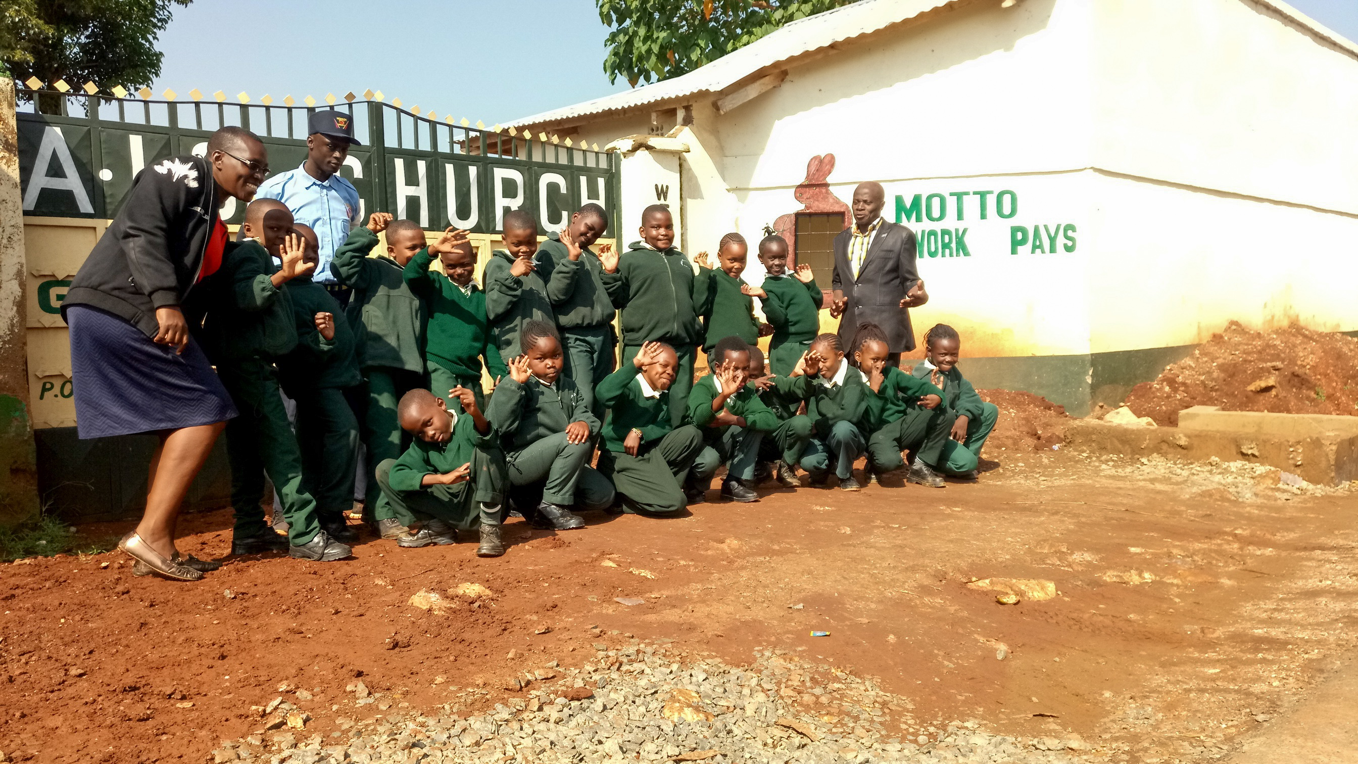 The Water Project : 2-kenya19003-our-team-members-posing-with-students-at-school-gate