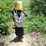 The Water Project: Mukoko Community, Mshimuli Spring -  Emily Vihenda Carrying Water Back From Mshimuli Spring