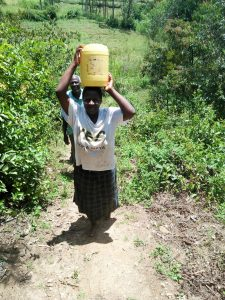 The Water Project:  Emily Vihenda Carrying Water Back From Mshimuli Spring