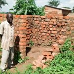 The Water Project: Alimugonza Pabidi Community -  Peter Okello In The Midst Of Building A New Latrine