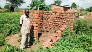 The Water Project:  Peter Okello In The Midst Of Building A New Latrine