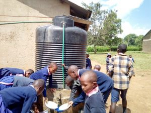The Water Project:  Students Getting Water From One Of The Plastic Tanks