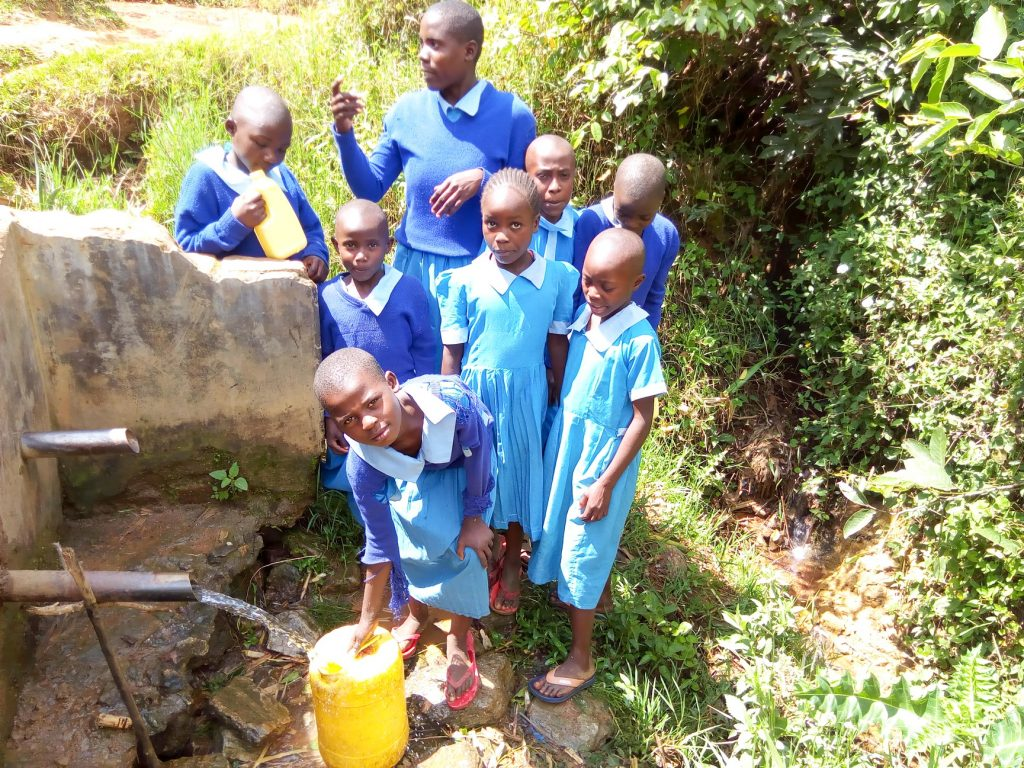The Water Project : 9-kenya18084-fetching-water-from-the-community