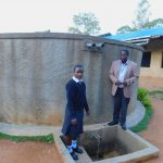 The Water Project: Bumira Secondary School -  Elizabeth Koome And Principal Rocken Ilahalwa Pose At The Tank