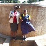 The Water Project: Kakubudu Primary School -  Field Officer Janet Kayi And Juliana Nekesa