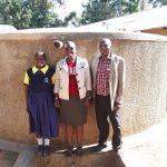 The Water Project: Kakubudu Primary School -  Juliana Nekesa Janet Kayi And Mr Solomon Busumu At The Tank