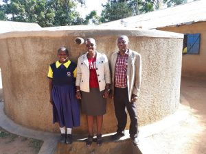 The Water Project:  Juliana Nekesa Janet Kayi And Mr Solomon Busumu At The Tank