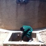 The Water Project: Essaba Primary School -  A Student Gathers Water At The Tank