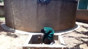 The Water Project:  A Student Gathers Water At The Tank