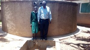 The Water Project:  Deputy Headteacher John Amukowa And Magret Anyona