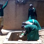 The Water Project: Essaba Primary School -  Girls Fetch Water At The School