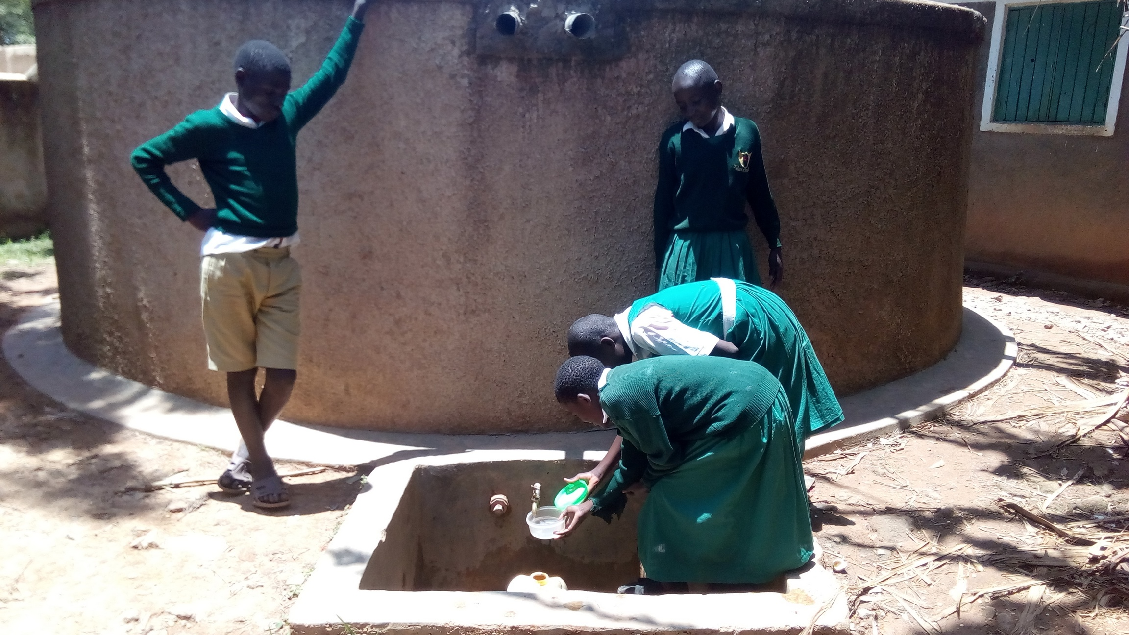 The Water Project : kenya4658-girls-fetch-water-at-the-school