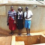 The Water Project: Mwiyenga Primary School -  Field Officer Betty Muhongo With Mary Lamuka And Protus Musonye