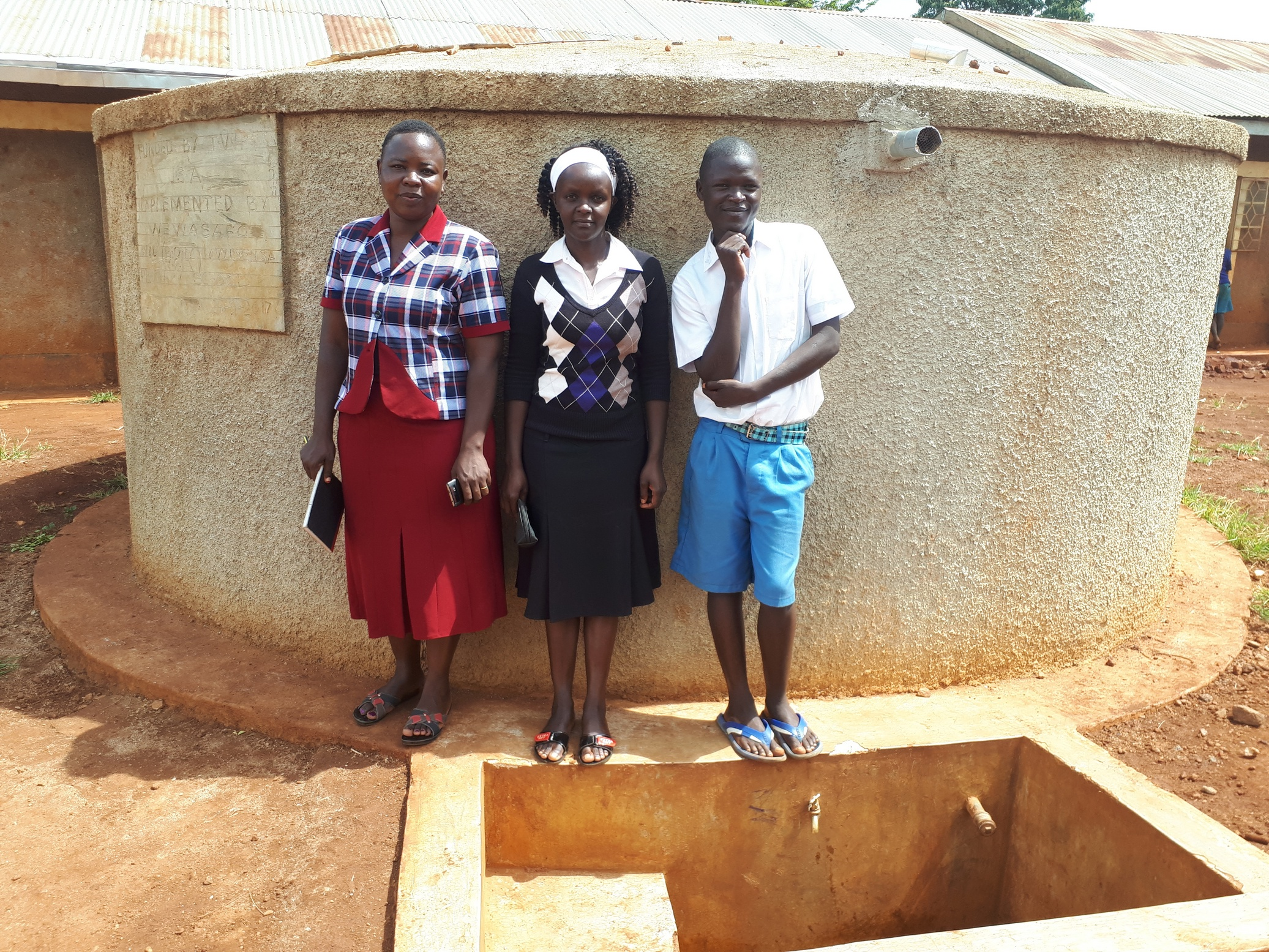 The Water Project : kenya4673-field-officer-betty-muhongo-with-mary-lamuka-and-protus-musonye