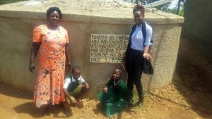 The Water Project:  Esther Asitiba And Agnes Mbooni Pose At The Tank With Field Officer Lillian Achieng