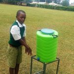 The Water Project: Esibuye Primary School -  Student Demonstrates Using A Handwashing Station