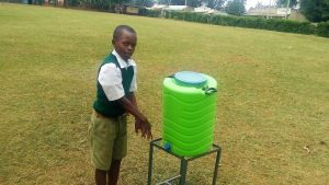 The Water Project:  Student Demonstrates Using A Handwashing Station