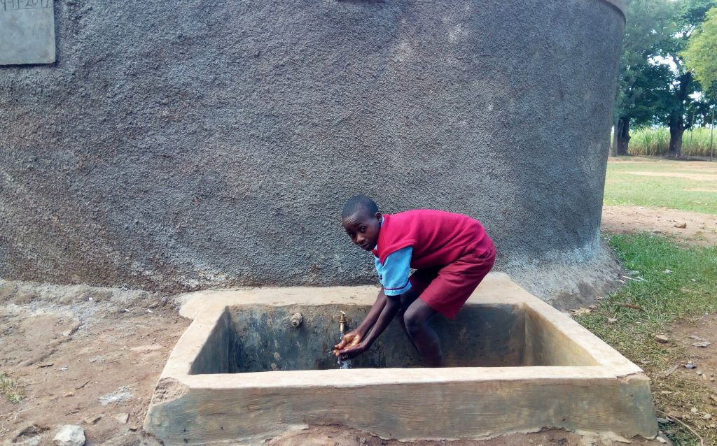 The Water Project : kenya4678-augustine-murunga-fetches-water