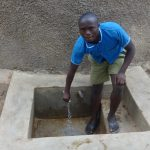 The Water Project: Malaha Primary School -  Kevin Lutomia Fetches Water At The Tank