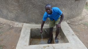The Water Project:  Kevin Lutomia Fetches Water At The Tank