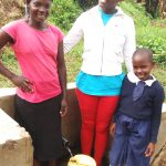 The Water Project: Shiamboko Community, Oluchinji Spring -  Betty Nambiro Field Officer Jemmimah Khasoha And Emily Amwai
