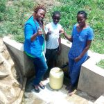 The Water Project: Lutali Community, Lukoye Spring -  Thumbs Up From Field Officer Jacklyne Chelagat Fidelis Shanguya And Agnes Esendi