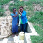 The Water Project: Lutali Community, Lukoye Spring -  High Fives With Agnes Esendi