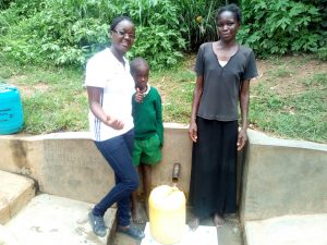 The Water Project:  Field Officer Olivia Bomji Poses With Samson Matunda And His Mother At The Spring