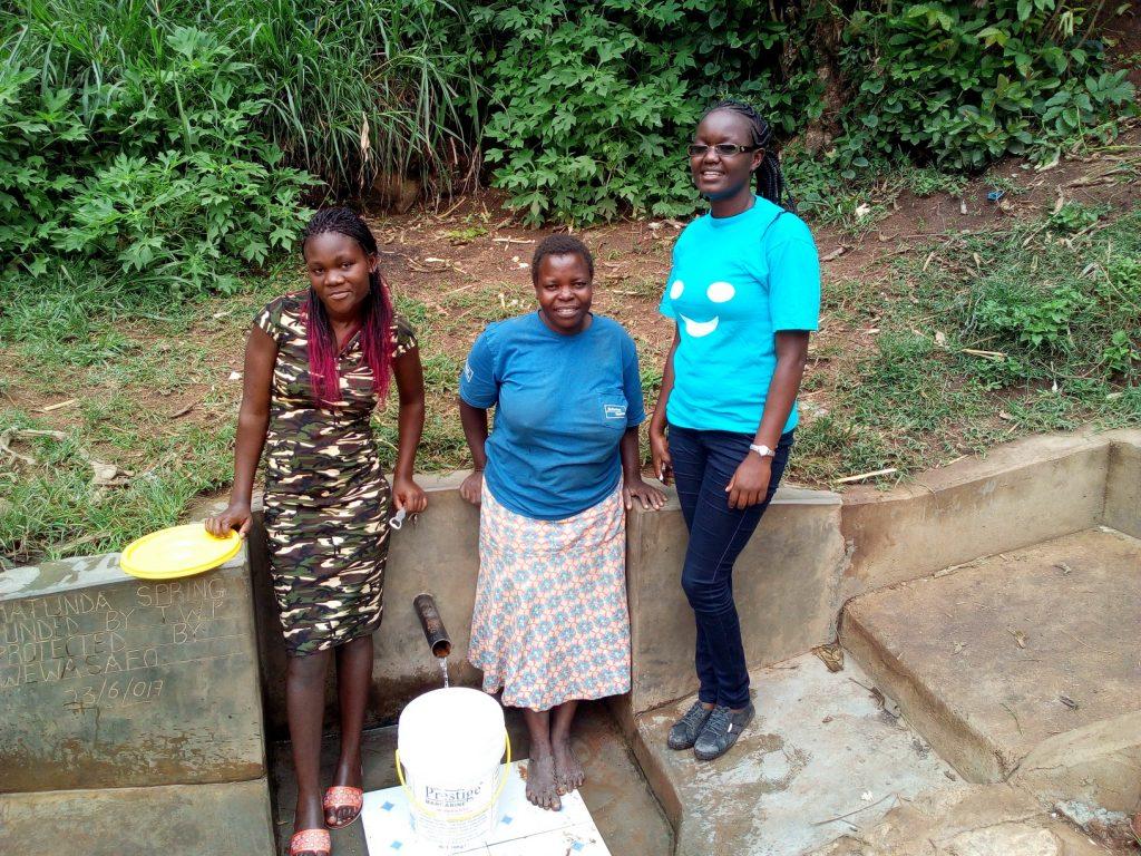 The Water Project : kenya4739-magdalyne-wasambili-and-field-officer-olivia-bomji-at-the-spring