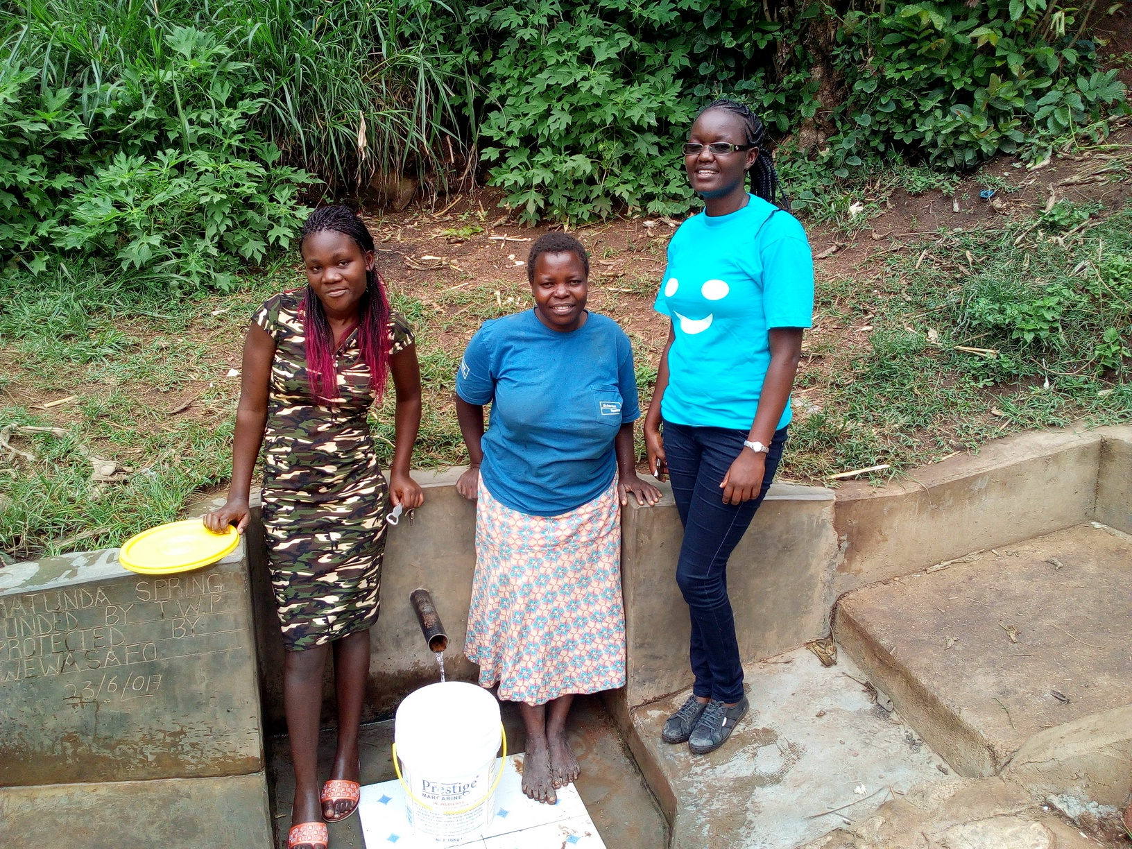 The Water Project : kenya4739-magdalyne-wasambili-and-field-officer-olivia-bomji-at-the-spring