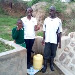 The Water Project: Mukhuyu Community, Shikhanga Spring -  Brighton Lirumba Field Officer Olivia Bomji And Charles Ashikanga