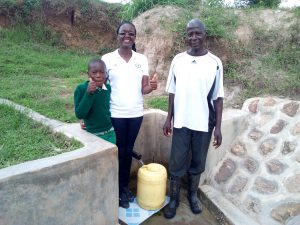 The Water Project:  Brighton Lirumba Field Officer Olivia Bomji And Charles Ashikanga