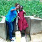The Water Project: Mungulu Community, Zikhungu Spring -  Field Officer Jacklyne Chelagat And Pamela Atieno