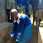 The Water Project: Eregi Mixed Primary School -  Fetching Water