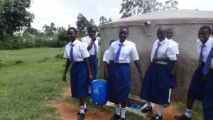 The Water Project:  Students Fill Handwashing Station With Water