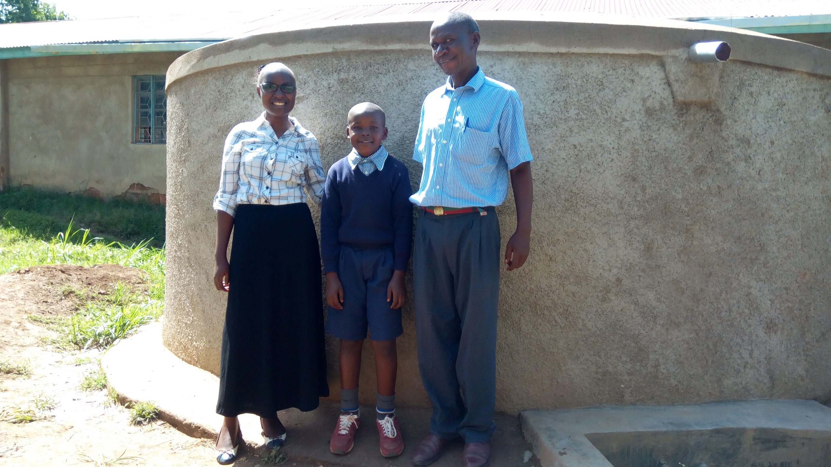 The Water Project : kenya4836-field-officer-joan-were-churchill-imbenzi-and-phillip-sunguti
