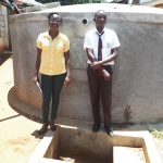 The Water Project: Mwitoti Secondary School -  Field Officer Olivia Bomji With Kennedy Munyani
