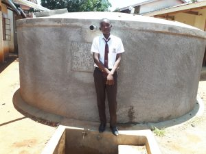 The Water Project:  Kennedy Munyani A Student At The Water Tank