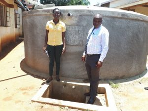 The Water Project:  Our Field Officer With The Principal Of Mwitoti School