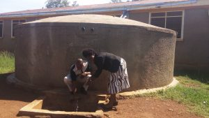 The Water Project:  Francis Owamu And Field Officer Karen Maruti