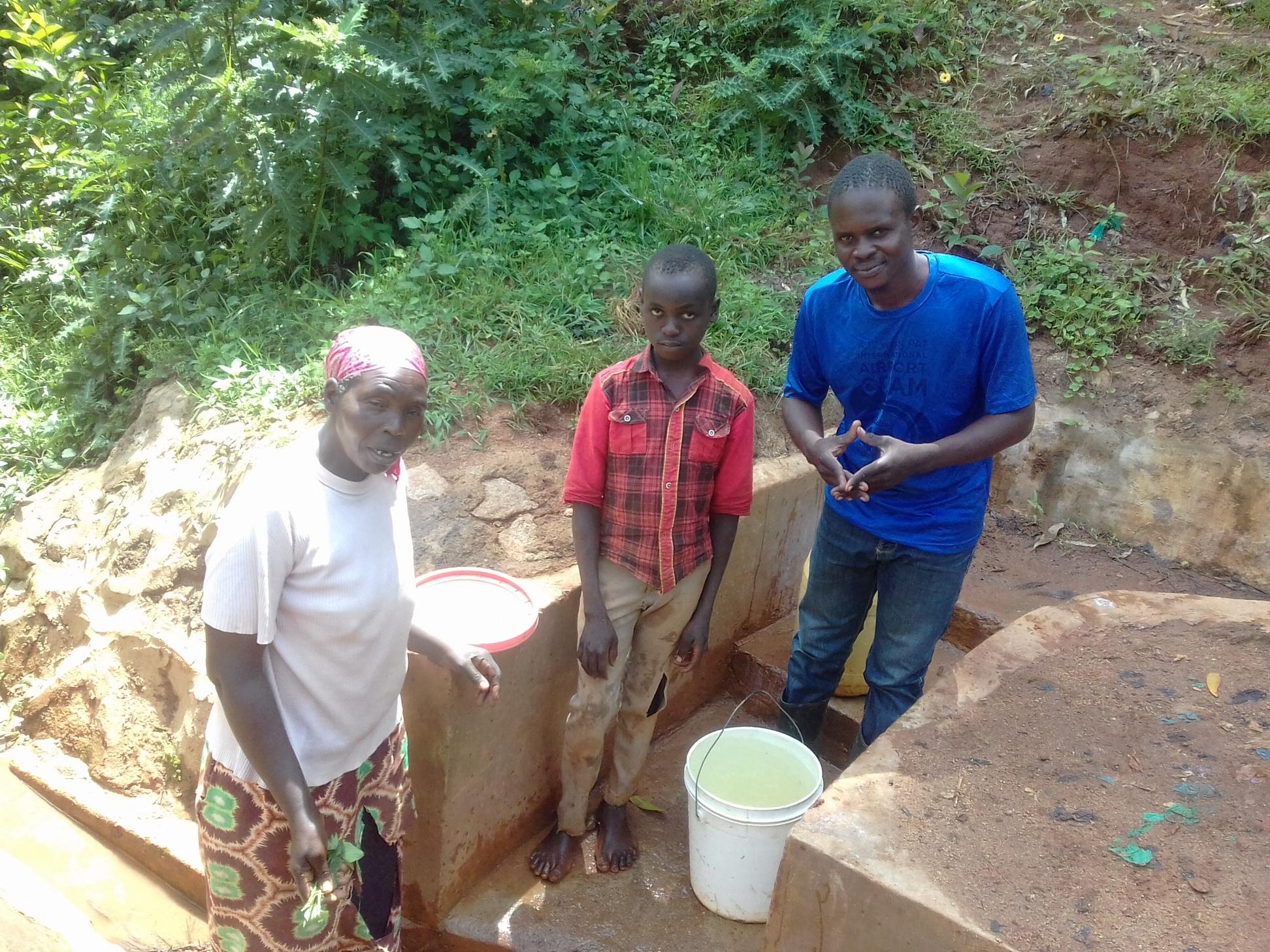 The Water Project : kenya4852-margaret-lihanda-derick-maraha-and-field-officer-samuel-simidi